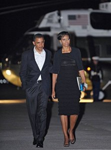 Barack Obama and Michelle Obama make their way to board Air Force One. AFP